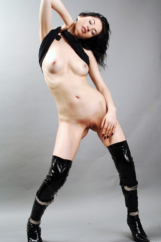 Aida D: Regina, by Andre Le Favori, pale skinned model in wild black boots